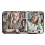Woman and granddaughter reading together barely there iPod covers