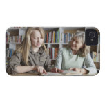 Woman and granddaughter reading together Case-Mate iPhone 4 cases