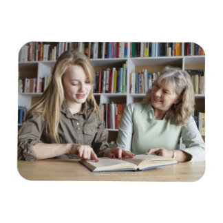 Woman and granddaughter reading together rectangular magnet