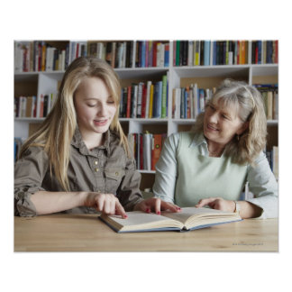 Woman and granddaughter reading together poster