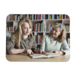 Woman and granddaughter reading together rectangular photo magnet