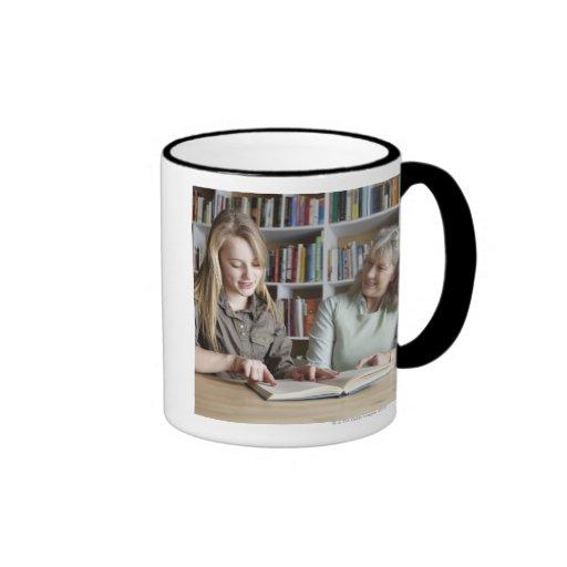 Woman and granddaughter reading together ringer mug