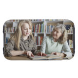 Woman and granddaughter reading together tough iPhone 3 cover