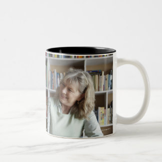 Woman and granddaughter reading together Two-Tone coffee mug