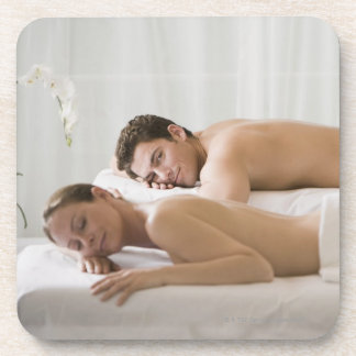 woman and man lying on massage benches coaster