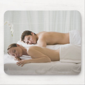 woman and man lying on massage benches mouse mat