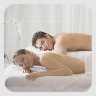 woman and man lying on massage benches square sticker