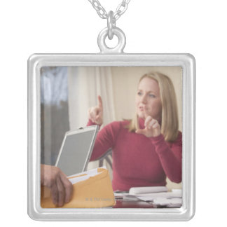 Woman and man signing the word 'Envelope' in Silver Plated Necklace
