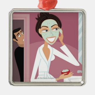 Woman applying facial mask christmas ornament