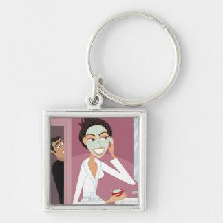 Woman applying facial mask key ring