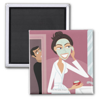 Woman applying facial mask square magnet