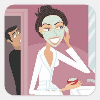 Woman applying facial mask square sticker