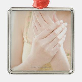 Woman Applying Hand Care Cream Christmas Ornament