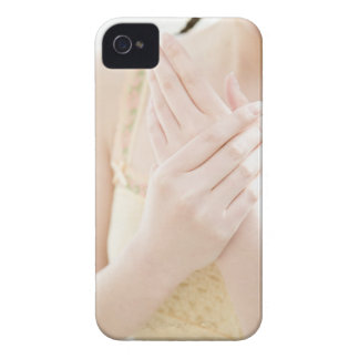 Woman Applying Hand Care Cream iPhone 4 Case