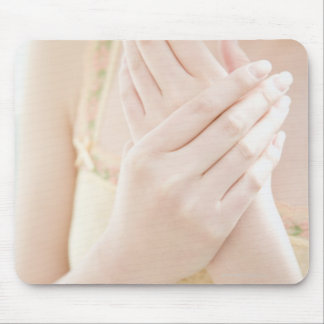 Woman Applying Hand Care Cream Mouse Mat