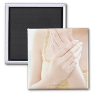Woman Applying Hand Care Cream Square Magnet