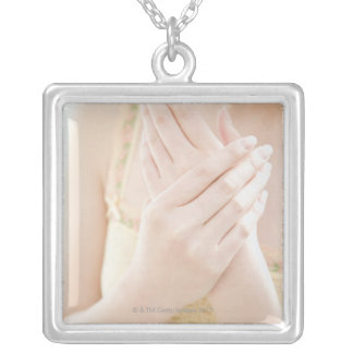Woman Applying Hand Care Cream Square Pendant Necklace