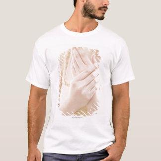 Woman Applying Hand Care Cream T-Shirt