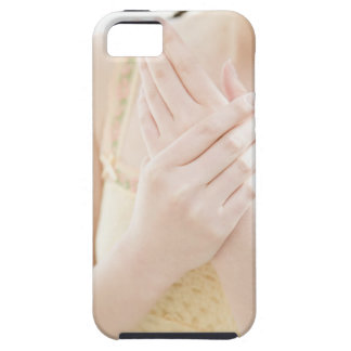 Woman Applying Hand Care Cream Tough iPhone 5 Case