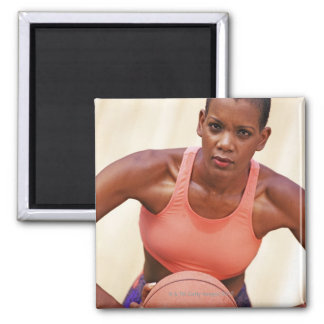 Woman basketball player magnet