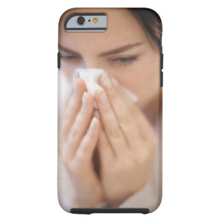 Woman blowing her nose. tough iPhone 6 case