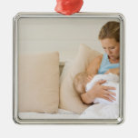Woman breastfeeding baby christmas ornament