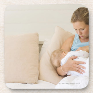 Woman breastfeeding baby drink coasters