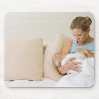 Woman breastfeeding baby mouse pad