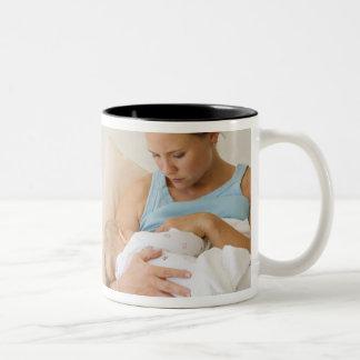 Woman breastfeeding baby mugs