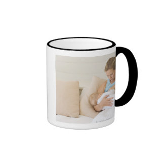 Woman breastfeeding baby mug