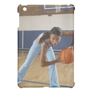 Woman crouching with basketball, portrait cover for the iPad mini