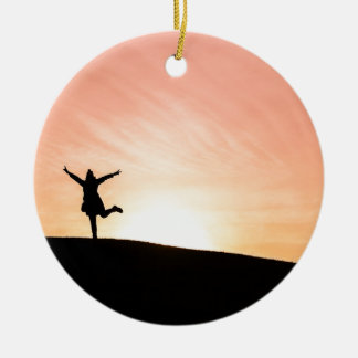 Woman dancing against the setting sun round ceramic decoration