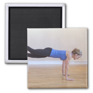 Woman doing exercise pose square magnet