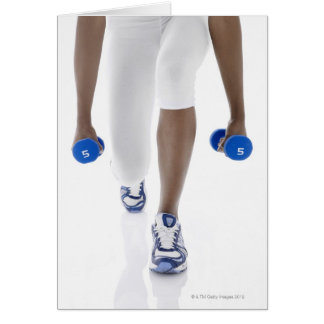 Woman doing lunges with dumbbells (low section) greeting card