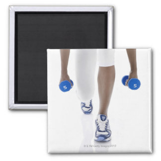 Woman doing lunges with dumbbells (low section) square magnet