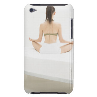 Woman doing yoga barely there iPod case