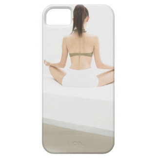 Woman doing yoga iPhone 5 covers