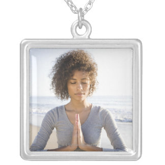 Woman doing yoga on beach silver plated necklace
