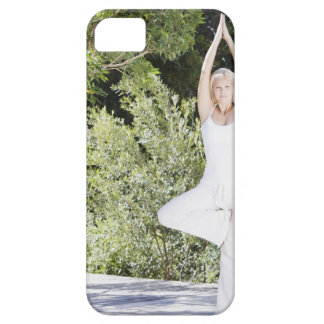Woman doing yoga on patio iPhone 5 covers