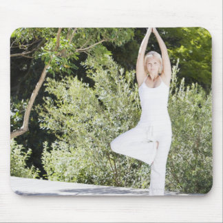 Woman doing yoga on patio mouse mat