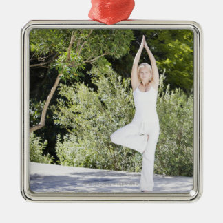 Woman doing yoga on patio Silver-Colored square decoration