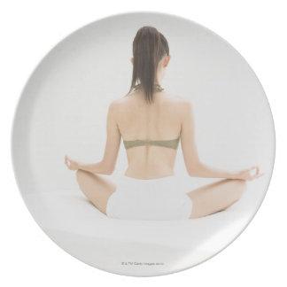 Woman doing yoga plate