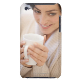 Woman drinking a hot drink. iPod touch cover