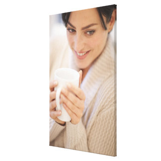 Woman drinking a hot drink. stretched canvas prints