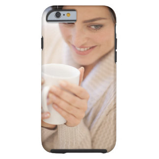 Woman drinking a hot drink. tough iPhone 6 case