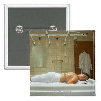 Woman enjoying hydrotherapy in vichy shower 15 cm square badge