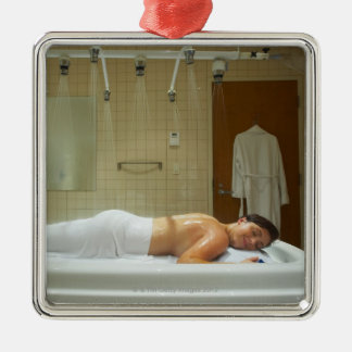 Woman enjoying hydrotherapy in vichy shower christmas ornament