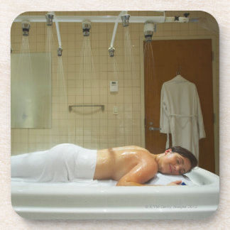 Woman enjoying hydrotherapy in vichy shower coaster