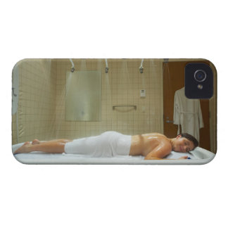 Woman enjoying hydrotherapy in vichy shower iPhone 4 cases