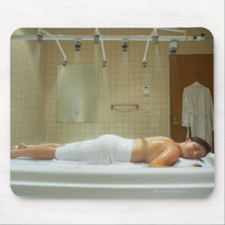 Woman enjoying hydrotherapy in vichy shower mouse pad